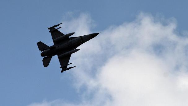 Turkish fighter jets shot down a Syrian warplane after it violated Turkey's airspace (AP)