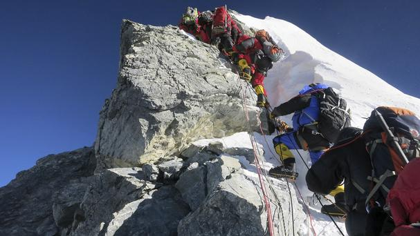 Climbers navigate the Hillary Step just below the summit of Mount Everest, in the Khumbu region of the Nepal Himalayas (AP/Alpenglow Expeditions, Adrian Ballinger)