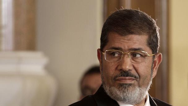 An Egyptian court has sentenced 529 supporters of ousted Islamist president Mohammed Morsi to death (AP)