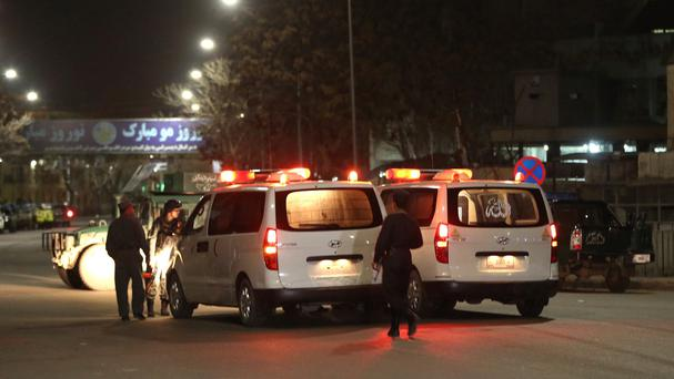 Afghan police forces stop and search ambulances at the site of a gun attack at the Serena Hotel in Kabul (AP Photo/Massoud Hossaini, File)