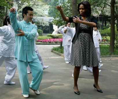 US first lady Michelle Obama practises tai chi at Chengdu High School in China's Sichuan province. AP