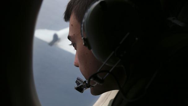 Sgt Matthew Falanga, on board a Royal Australian Air Force AP-3C Orion, searches for the missing Malaysia Airlines plane (AP)