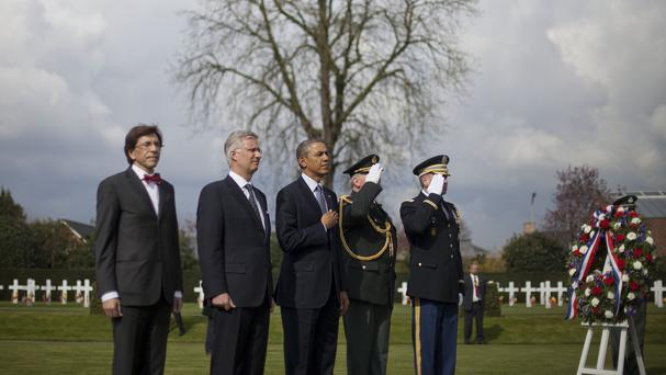 Belgium's prime minister Elio Di Rupo, King Philippe and US President Barack Obama attend a wreath-laying ceremony at Flanders Field America Cemetery (AP)