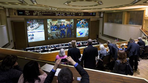 The Russian Mission Control Centre shows live television of the Expedition 39 crew members on the International Space Station after the Soyuz TMA-12M docked (AP)