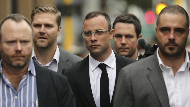 Oscar Pistorius (centre) will give evidence for the first time during his trial
