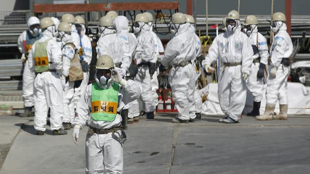 A worker has died at the Japanese nuclear plant devastated by the 2011 tsunami after getting buried in a mudslide (AP)