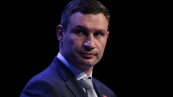 Vitali Klitschko said he will back Petro Poroshenko in the Ukrainian presidential elections (AP)
