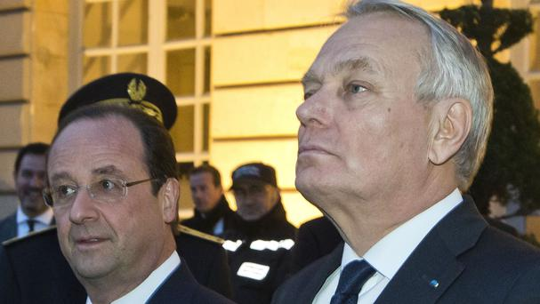 French President Francois Hollande, left, with Jean-Marc Ayrault (AP)