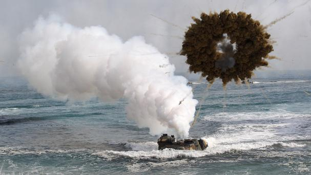 A South Korean marine LVT-7 landing craft sails through a smoke screen during joint landing exercises with the US (AP)