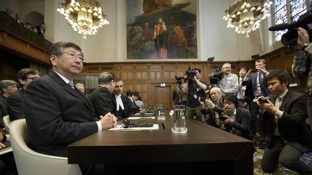 Japanese ambassador Koji Tsuruoka waits for the International Court of Justice to deliver its whaling verdict. (AP)