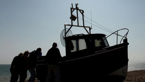 Five members of a Spanish fishing boat's crew were rescued after a crash