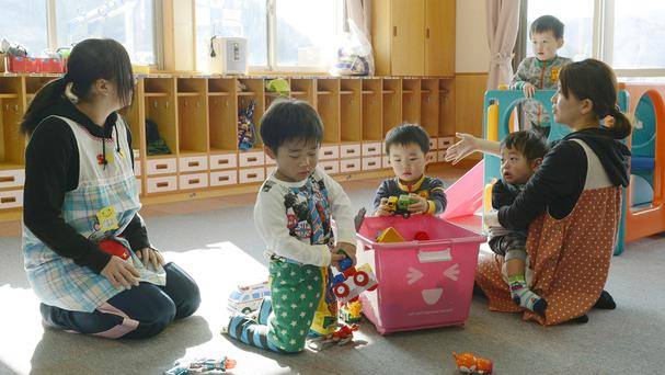 Toddlers play at a nursery school in Tamura, Fukushima, after authorities allowed residents to return to their homes (AP/Kyodo News)