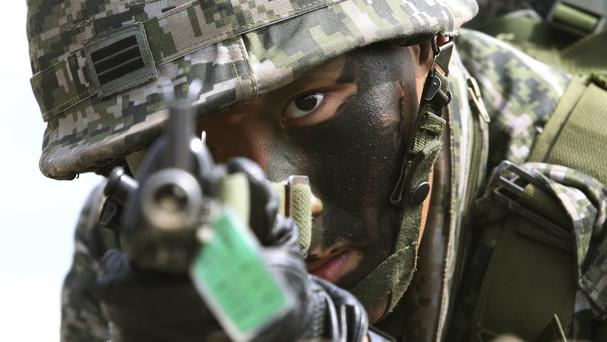 A South Korean marine aims his machine gun during US-South Korea military exercises (AP)