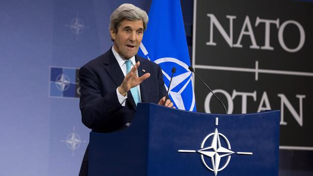 US Secretary of State John Kerry speaks after a meeting at Nato headquarters in Brussels (AP)