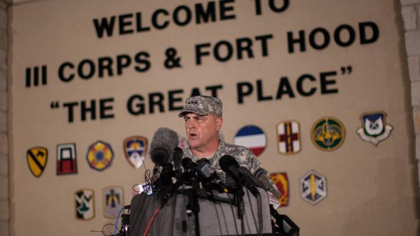 Lieutenant General Mark Milley, commanding general of Fort Hood, speaks to the media outside the base (AP)