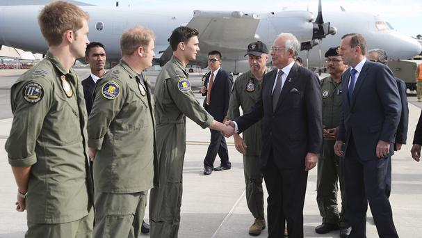 Malaysian PM Najib Razak, centre, and Australia's PM Tony Abbott greet RAAF crew involved in the search for MH370 in Perth, Australia (AP)