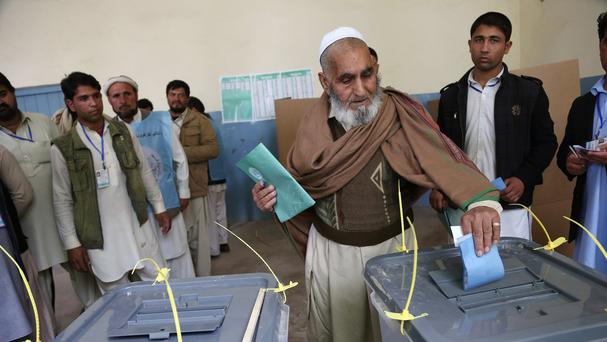 A man casts his vote at a polling station in Jalalabad (AP)