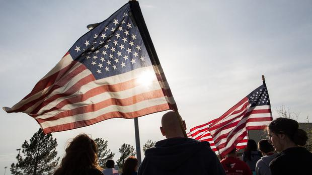 Members of the military, veterans and civilians march to pay tribute to the victims and families affected by the Fort Hood shooting (AP)