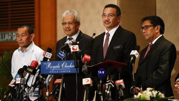 Malaysian ministers said they are 'cautiously hopeful' there will be positive developments in the next few days, 'if not hours', in the search for the missing airliner. (AP)