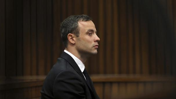 Oscar Pistorius sits in the dock at a court in Pretoria. (AP)