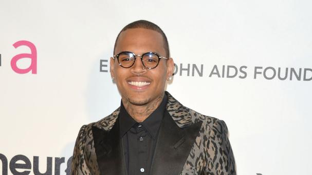 Chris Brown is accused of punching a man outside a Washington hotel