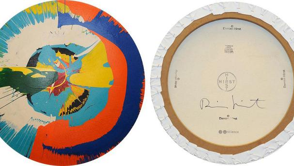 The front and back of a counterfeit Damien Hirst spin painting. Miami pastor Kevin Sutherland knowingly peddled phony examples of some of Hirst's signature themes, prosecutors said (AP)