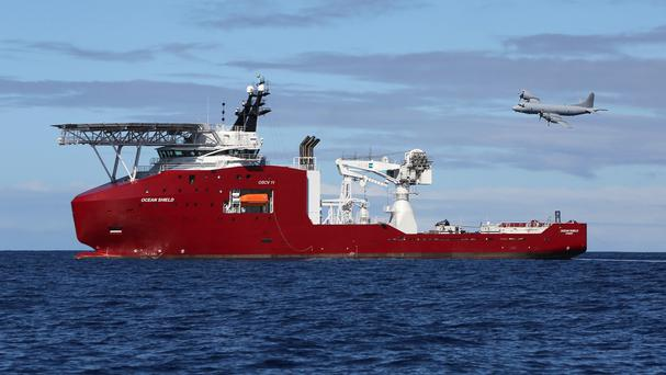 A plane flies past Australian defence vessel Ocean Shield on a mission to drop sonar buoys to assist in the search for the missing Malaysia Airlines jet. (AP/Australian Defence Force)