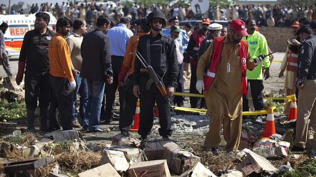 Police at the scene of the blast in Islamabad, Pakistan (AP)