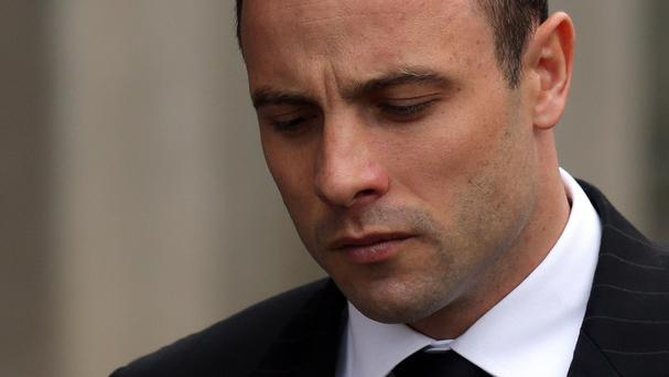 Oscar Pistorius arrives at the high court in Pretoria to give evidence for a third day (AP)