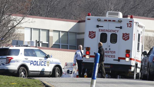 Emergency responders gather in the car park of the high school on the campus of the Franklin Regional School District (AP)