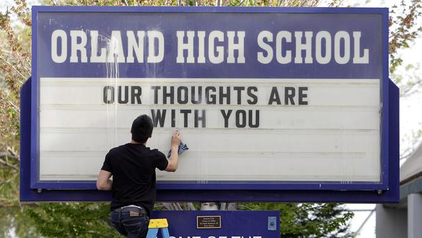 Orland High School's sign displays a memorial remembering the victims of a fiery crash between a tour bus and a FedEx truck in Orland, California (AP)