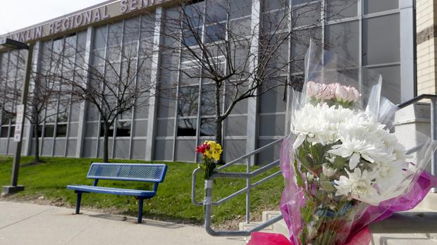 Flowers at the scene of a stabbing rampage at a high school near Pittsburgh (AP)