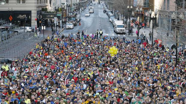 A crowd gathers at the finish line of the Boston Marathon for a photo shoot to commemorate the one-year anniversary of the bombing (AP)