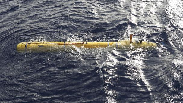 A robotic submarine was hauled back to the surface of the Indian Ocean as the search area for the missing Malaysian jet proved too deep for the craft. (AP/Australian Defence Force, Lt Kelli Lunt)
