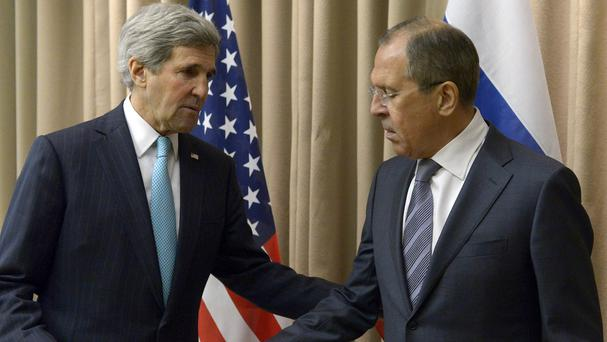 US Secretary of State John Kerry, left, shakes hands with Russian Foreign Minister Sergey Lavrov before a bilateral meeting to discuss the situation in Ukraine in Geneva (AP)