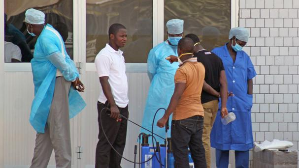 Emergency medical personnel wait to receive suspected Ebola patients in Guinea (AP)