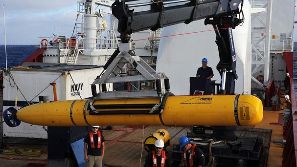 A robotic submarine has headed back down into the depths of the Indian Ocean to scour the sea floor for any trace of the missing Malaysian jet. (AP/US Navy, MC1 Peter D Blair)