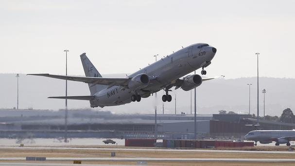 A US Navy P-8 Poseidon takes off from Perth on the way to rejoin the search for missing Malaysia Airlines Flight 370 (AP)