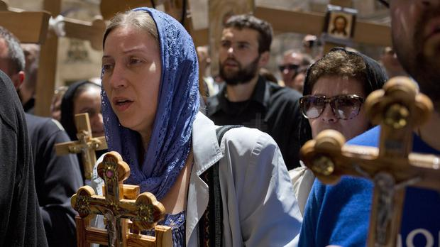 Pilgrims carry crosses during Good Friday in Jerusalem as Christians commemorated the crucifixion of Jesus Christ (AP)