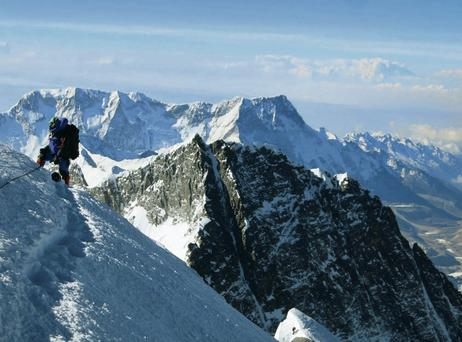 A climber pauses on the way to the summit