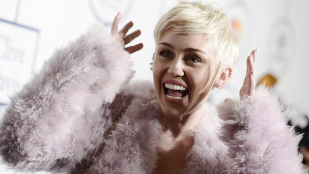 Miley Cyrus has postponed her US tour until August