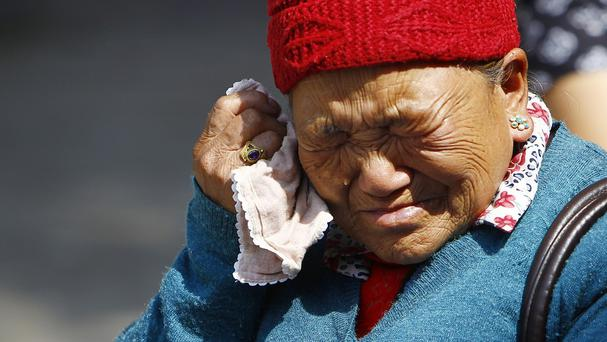 Mother of Nepalese mountaineer Ang Kaji Sherpa, who was killed in an avalanche on Mount Everest (AP)