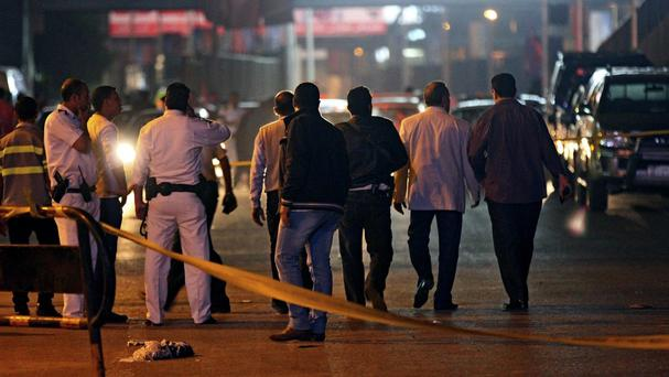Police and security focus seal off the site of a bomb attack in Cairo (AP Photo/Hussein Tallal)