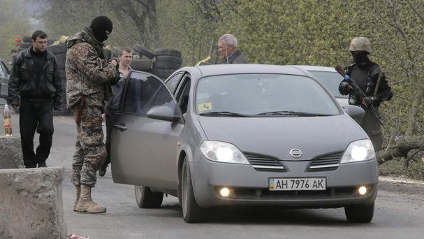 Pro-Russian gunmen have been setting up checkpoints in eastern Ukraine (AP Photo/Efrem Lukatsky)