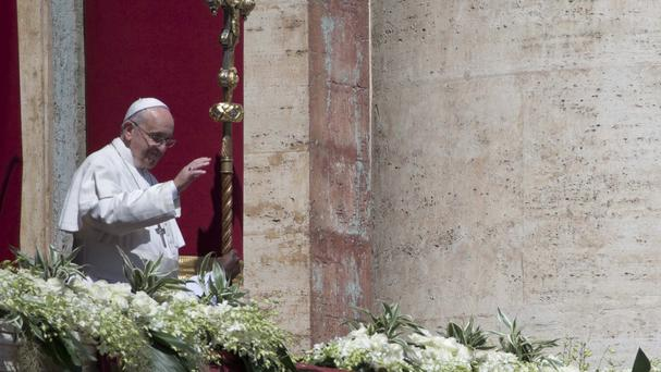 Pope Francis delivers a blessing from the balcony of St Peter's Basilica (AP Photo/Alessandra Tarantino)