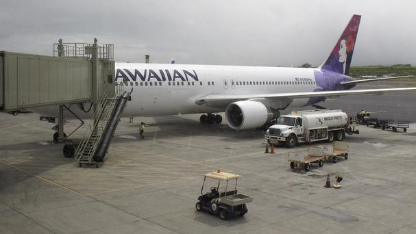 The Hawaiian Airlines plane on which a 15-year-old boy flew for five freezing hours stowed away in a wheel well (AP)