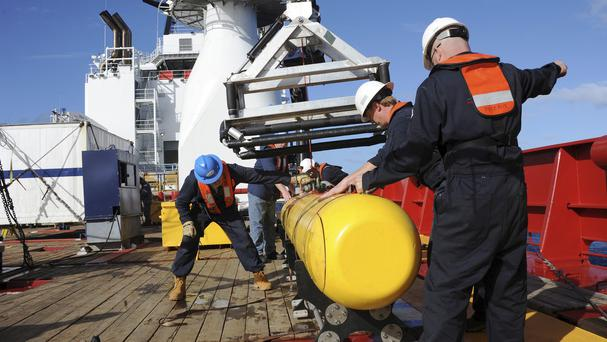 The Bluefin 21, Artemis autonomous underwater vehicle is hoisted back on board Australian vessel Ocean Shield as search efforts continue for missing Malaysia Airlines Flight 370 (US Navy/AP)