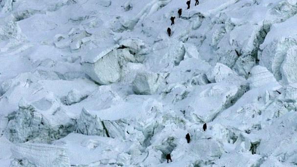 Mountaineers pass through the treacherous Khumbu Icefall on their way to Mount Everest near Everest Base Camp in Nepal (AP Photo/Gurinder Osan, File)