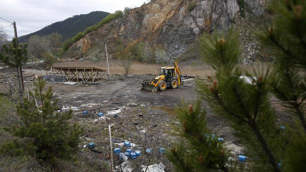 A general view of a mass grave site in the village of Rudnica, Serbia (AP)