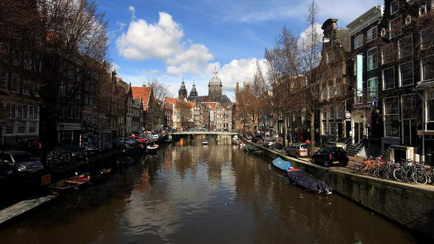 "Amsterdam is cracking down on ""coffee shops"" where marijuana is sold."